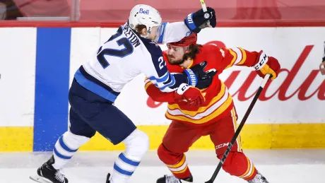 Jets punch ticket to playoffs on milestone night in shutout of Flames
