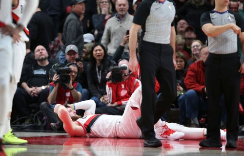 Blazers lose Nurkic to severe leg injury, edge Nets in 2 OTs